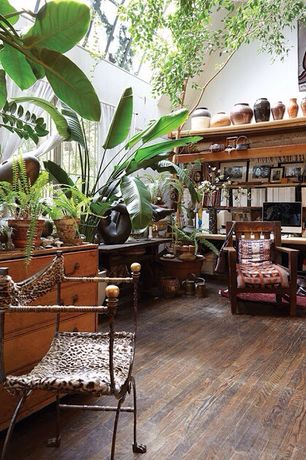 Rustic Home Office with Built-in bookshelf, Skylight, Hardwood floors, High ceiling