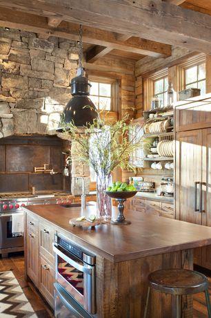 Country Kitchen with flush light, Mohawk hardwood : greyson distressed, Slate Tile, Wood counters, Breakfast bar, Flush