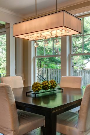 Contemporary Dining Room with Standard height, Crown molding, flush light, Hardwood floors, double-hung window