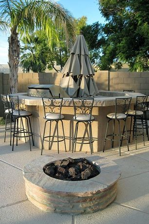 Mediterranean Patio with Outdoor kitchen, Fire pit, exterior tile floors, exterior concrete tile floors, Fence