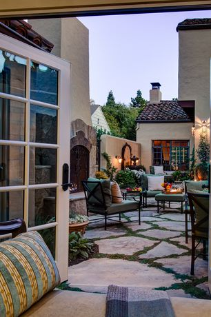 Mediterranean Patio with Casement, exterior stone floors, French doors, Exterior accent lighting