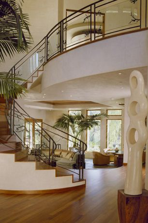 Modern Staircase with Cathedral ceiling, Hardwood floors