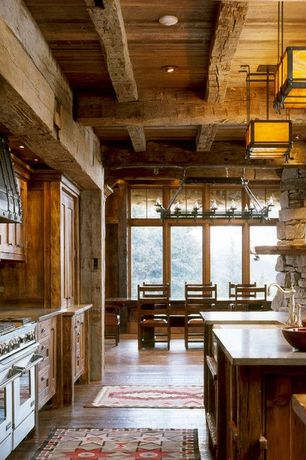 Rustic Kitchen with Standard height, Inset cabinets, can lights, European Cabinets, Reclaimed wood, One-wall, Custom hood