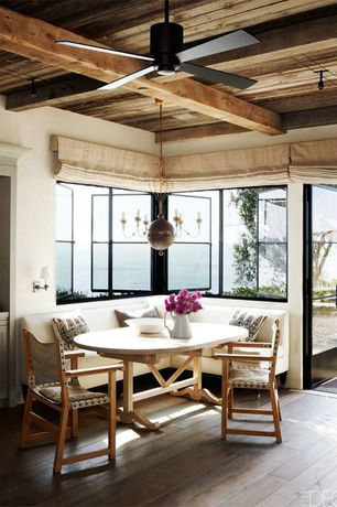 Cottage Dining Room with Laminate floors, Exposed beam, Pottery Barn - Great White Dinnerware, Ceiling fan, Pendant light