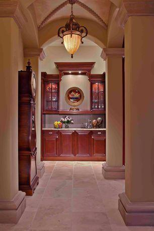 Mediterranean Bar with Columns, High ceiling, flush light, travertine tile floors, Crown molding