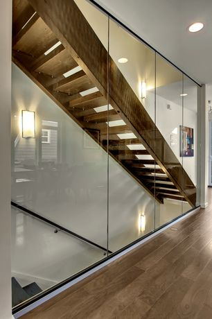 Contemporary Staircase with Wall sconce, Floating staircase, can lights, Hardwood floors, Standard height