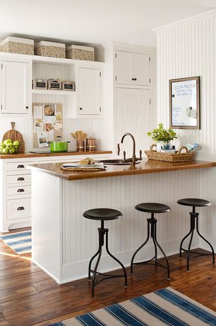 Cottage Kitchen with Kitchen peninsula, European Cabinets, Wood counters, Adjustable Height Metallic Steel Twist Stool