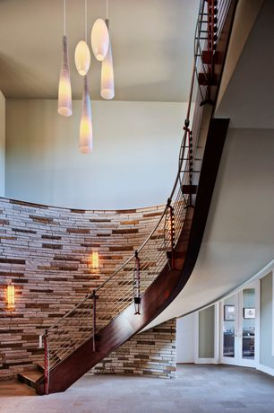 Contemporary Staircase with Wall sconce, Laminate floors, High ceiling