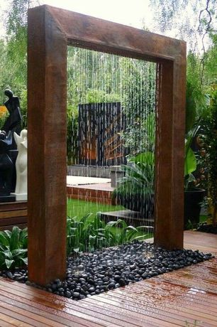Modern Landscape/Yard with Corten steel rain curtain water features, Stone platform