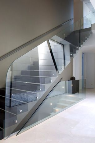 Modern Staircase with Glass staircase, Floating staircase, High ceiling, Hardwood floors