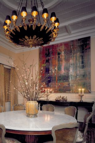 Eclectic Dining Room with Standard height, Wainscotting, Crown molding, Carpet, Chandelier