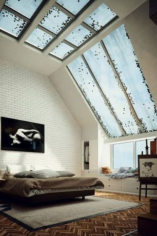 Modern Master Bedroom with interior brick, Skylight, Window seat, Hardwood floors, High ceiling, Built-in bookshelf