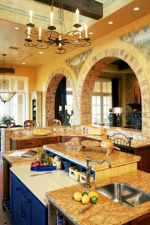 Mediterranean Kitchen with L-shaped, Breakfast bar, terracotta tile floors, Chandelier, Complex granite counters, can lights