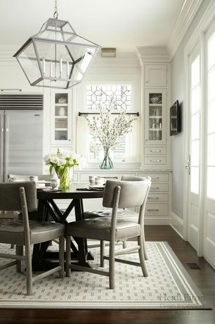 Traditional Dining Room with Glass panel door, Pendant light, Standard height, Crown molding, Built-in bookshelf