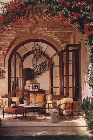Mediterranean Porch with exterior stone floors, French doors