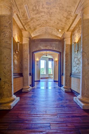 "Mediterranean Hallway with Wall sconce, Columns, Virginia mill works  3/4"" x 4-3/4"" mezzo mahogany handscraped, High ceiling"