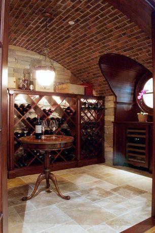 Traditional Wine Cellar with French doors, slate floors, Built-in bookshelf, flush light