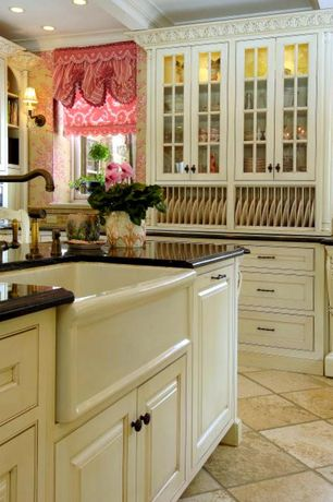 Traditional Kitchen with limestone tile floors, can lights, Kitchen island, interior wallpaper, Farmhouse sink, Casement