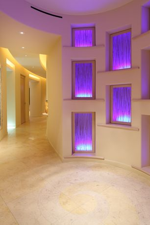 Modern Hallway with can lights, terracotta tile floors, picture window, High ceiling