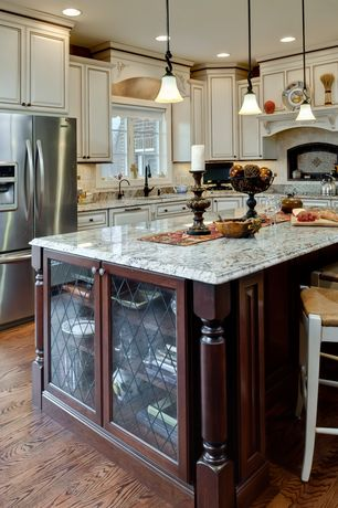 Traditional Kitchen with Kitchen island, Custom hood, full backsplash, Built In Refrigerator, Framed Partial Panel, Casement