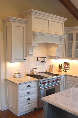 Traditional Kitchen with European Cabinets, L-shaped, Custom hood, Exposed beam, Framed Partial Panel, Raised panel, Cabinet