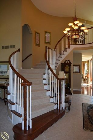 Traditional Staircase with Laminate floors, High ceiling, Chandelier