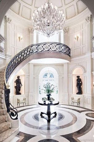 Art Deco Entryway with Wall sconce, High ceiling, Pendant light, Balcony, Uttermost Brynmore Round Table  Style # 3F881