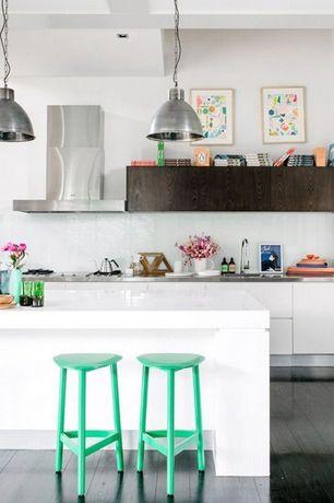 Contemporary Kitchen with Undermount sink, Hardwood floors, Pendant light, Corian counters, European Cabinets, Glass Tile