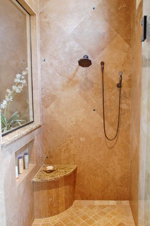Mediterranean Master Bathroom with Handheld showerhead, frameless showerdoor, Arizona Tile Giallo Veneziano Granite