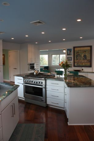 Eclectic Kitchen with can lights, Breakfast bar, flat door, Standard height, Casement, Undermount sink, Onyx counters