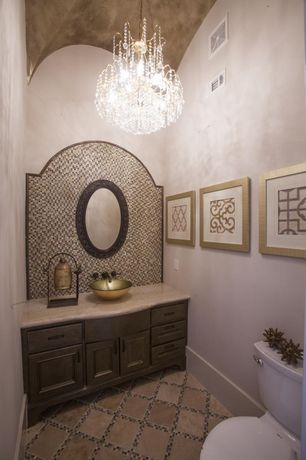 Mediterranean Powder Room with Vessel sink, Limestone counters, Powder room, Chandelier, Ceramic Tile, Inset cabinets