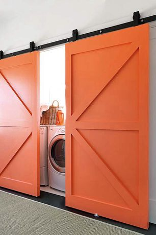 Contemporary Laundry Room with Concrete floors, laundry sink, Standard height, Paint 1, Barn door, Undermount sink