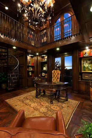 Craftsman Home Office with Hardwood floors, French doors, High ceiling, Built-in bookshelf, Loft