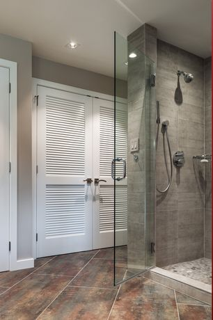 Contemporary Master Bathroom with frameless showerdoor, Handheld showerhead, Louvered door