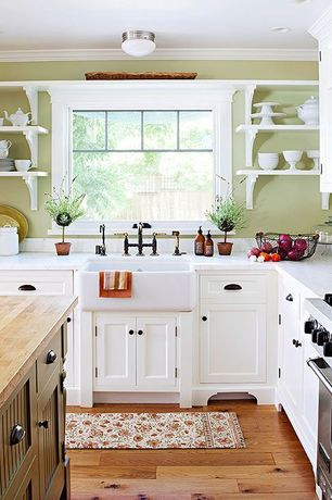 Country Kitchen with Hardwood floors, Farmhouse sink, European Cabinets, Flat panel cabinets, Century Hardware Apac Cup Pull