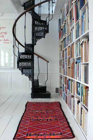 Contemporary Library with Wainscotting, bedroom reading light, Built-in bookshelf, Hardwood floors, Standard height