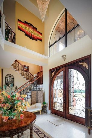 Mediterranean Front Door with French doors, Transom window, exterior stone floors