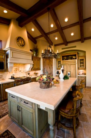 "Mediterranean Kitchen with Jerusalem limestone 4 size tiles, ""curvias elegante"" wrought iron chandelier, Flat panel cabinets"