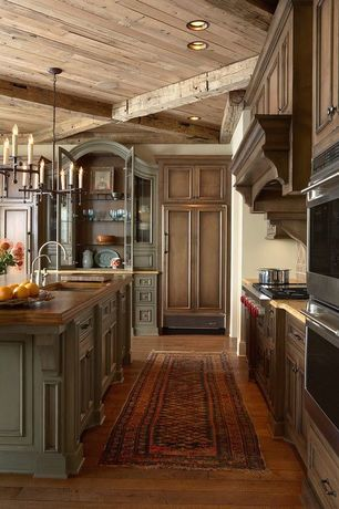 Cottage Kitchen with Wolf gas range gr484cg, Glass panel, Wood counters, Custom hood, Ceramic Tile, L-shaped, Pendant light