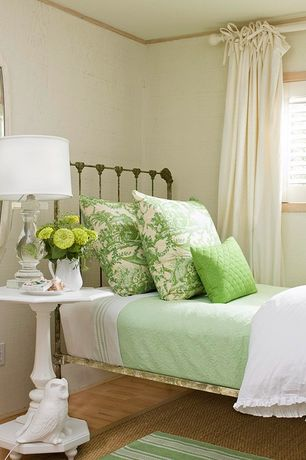Traditional Guest Bedroom with Crown molding, interior wallpaper, Hardwood floors