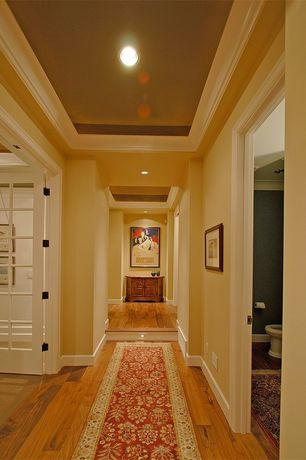 Traditional Hallway with Niche, Crown molding, Wide plank floors, Carpet runner, Trey ceiling, French doors, Hardwood floors