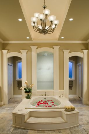 Traditional Master Bathroom with drop in bathtub, can lights, Chandelier, six panel door, Master bathroom, Standard height