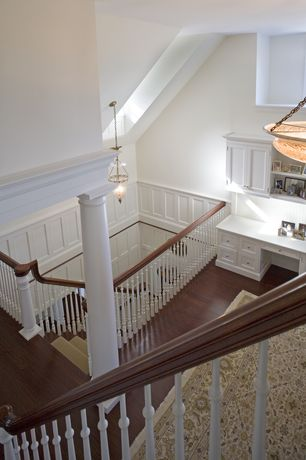 Traditional Staircase with Pendant light, Skylight, High ceiling, Laminate floors, Columns