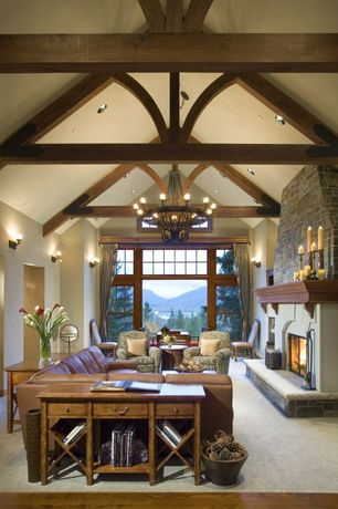 Craftsman Living Room with Built-in bookshelf, Hardwood floors, stone fireplace, Exposed beam, Wall sconce, Chandelier