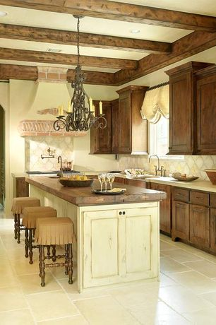 Mediterranean Kitchen with L-shaped, Limestone Tile, can lights, stone tile floors, dishwasher, Flat panel cabinets, Paint