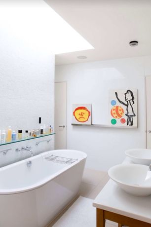 Contemporary Kids Bathroom with Freestanding, High ceiling, Bathtub, stone tile floors, Paint, can lights, Skylight