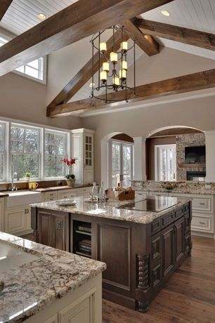 Traditional Kitchen with Complex granite counters, High ceiling, Hardwood floors, Kitchen island, Limestone, U-shaped, Flush