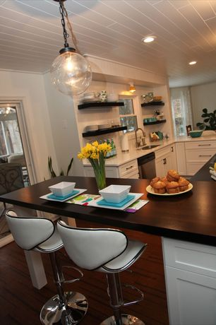Contemporary Kitchen with Pendant light, Limestone counters, L-shaped, Clear glass globe industrial pendant, Breakfast bar