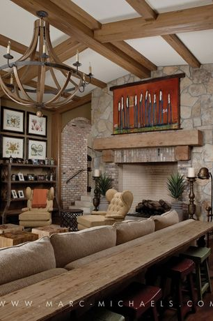 Eclectic Living Room with High ceiling, Exposed beam, Hardwood floors, Chandelier, brick fireplace, interior brick, Fireplace
