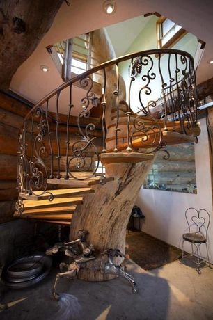 Eclectic Staircase with Spiral staircase, Decorative iron railing, Antique ice cream parlor chair, Natural wood tread